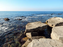Rocky shore of the Caspian Sea. Royalty Free Stock Photos