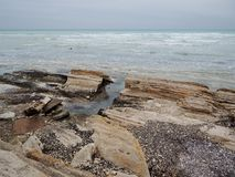 Rocky shore of the Caspian Sea. Mangistau region. Kazakhstan stock photography