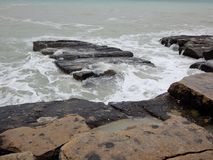 Rocky shore of the Caspian Sea. Mangistau region. Kazakhstan stock photo