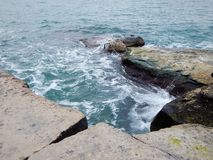 Rocky shore of the Caspian Sea. The month of February royalty free stock photo