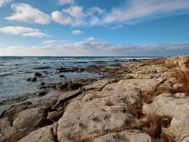 Caspian Sea. Rocky shore of the Caspian Sea. Month January. Stylized photo under the picture royalty free stock image