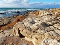 Caspian Sea. Rocky shore of the Caspian Sea. Month January. Stylized photo under the picture stock photos