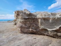 Rocky shore of the Caspian Sea. Lower point shooting. Close-up stock image