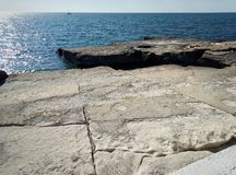 Rocky shore of the Caspian Sea stock images