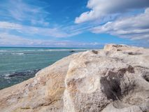 Rocky shore of the Caspian Sea. Seascape royalty free stock image