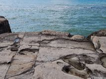 Rocky shore of the Caspian Sea. The texture of the stone royalty free stock image