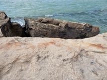 Rocky shore of the Caspian Sea. The texture of the stone stock photo