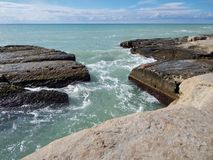 Rocky shore of the Caspian Sea. The texture of the stone stock photography