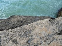Rocky shore of the Caspian Sea. The texture of the stone stock image