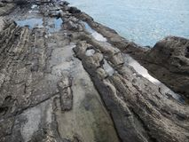 Rocky shore of the Caspian Sea. The texture of the stone royalty free stock photo
