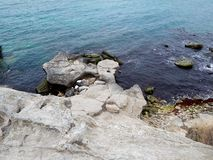 Rocky coast of the Caspian Sea royalty free stock images
