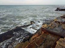 Rocky shore of the Caspian Sea. Caspian Sea, rocky shore. View of the stones. Winter season stock images
