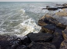 Rocky shore of the Caspian Sea. Caspian Sea, rocky shore. View of the stones. Winter season stock photography