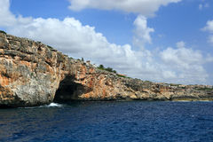 The rocky shore of the cave. Mallorca. Spain. The rocky shore of the cave, the view from the sea. Mallorca. Spain Royalty Free Stock Photos