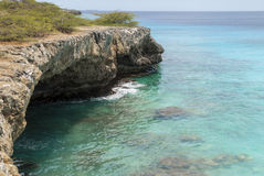 Rocky shore with caves Royalty Free Stock Image