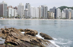 Rocky shore and a city background Royalty Free Stock Photos