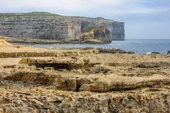 Rocky shore and cliffs near the Azure Window. Gozo Island, Malta Royalty Free Stock Photo