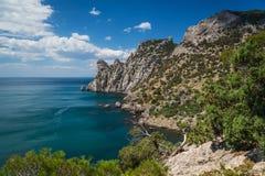 Rocky shore. Rocky coast of the Black Sea, blue bay Royalty Free Stock Image