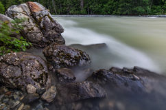 Rocky Shore with Flowing River Water Royalty Free Stock Photos