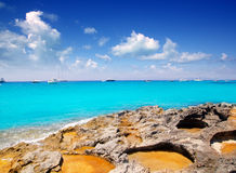 Rocky shore of formentera turquoise sea Stock Image