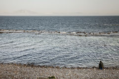 Rocky shore in front of Africa Royalty Free Stock Photo