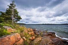 Rocky shore in Georgian Bay. Rocky lake shore of Georgian Bay in Killbear provincial park near Parry Sound, Ontario, Canada Stock Photo