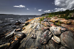 Rocky shore of Georgian Bay. Georgian Bay landscape with rugged rocky lake shore near Parry Sound, Ontario, Canada Stock Photography