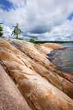 Rocky shore in Georgian Bay. Smooth rocky lake shore of Georgian Bay in Killbear provincial park near Parry Sound, Ontario, Canada Stock Images