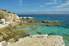 Rocky shore in Kassiopi, Greece Stock Images