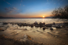 Rocky Shore of Lake Chiemsee at Sunrise Royalty Free Stock Image