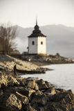 Rocky shore of the lake with sun rise Royalty Free Stock Photography