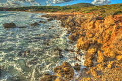 Rocky shore in Le Bombarde beach Stock Photography