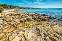 Rocky shore in Le Bombarde beach Royalty Free Stock Images
