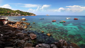 Rocky shore loop. Rocky shore with boats in the azure sea loop stock video footage
