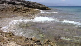 Rocky shore stock footage