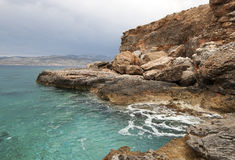 Rocky shore. In mediterranean sea Stock Photography