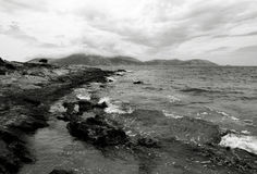 Rocky shore. In mediterranean sea in black and white Royalty Free Stock Photo