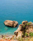 Rocky shore. In Mediterranean sea in summer day royalty free stock image