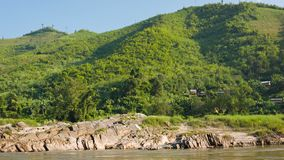 Rocky shore of the Mekong river. View from the boat. Laos Stock Image
