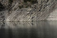 Rocky shore of a mountain lake. Close up stock photo