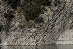 Rocky shore of a mountain lake. Close up stock photos