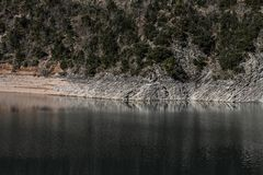 Rocky shore of a mountain lake. Close up royalty free stock photography