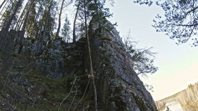 Rocky shore of a mountain river Chusovaya, Ural, Russia. Slider stock video footage