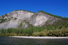 Rocky shore of the mountain river. Royalty Free Stock Photo