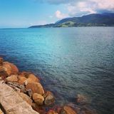 Rocky Shore and Mountains Ilhabela, Brazil Stock Image