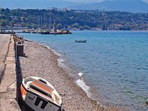 The rocky shore near Aigio, Greece on the Corinthian Gulf. A view up the coast of the Corinthian Gulf looking toward the town of Aigio, Greece Stock Photography