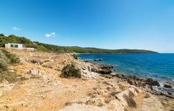 Rocky shore in Porto Conte Stock Images