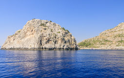 Rocky shore. Rhodes Island. Greece Royalty Free Stock Photo