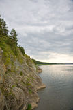Rocky shore river in cloudy day Stock Photos