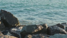 Rocky shore with rushing sea waves. Close shot stock video footage